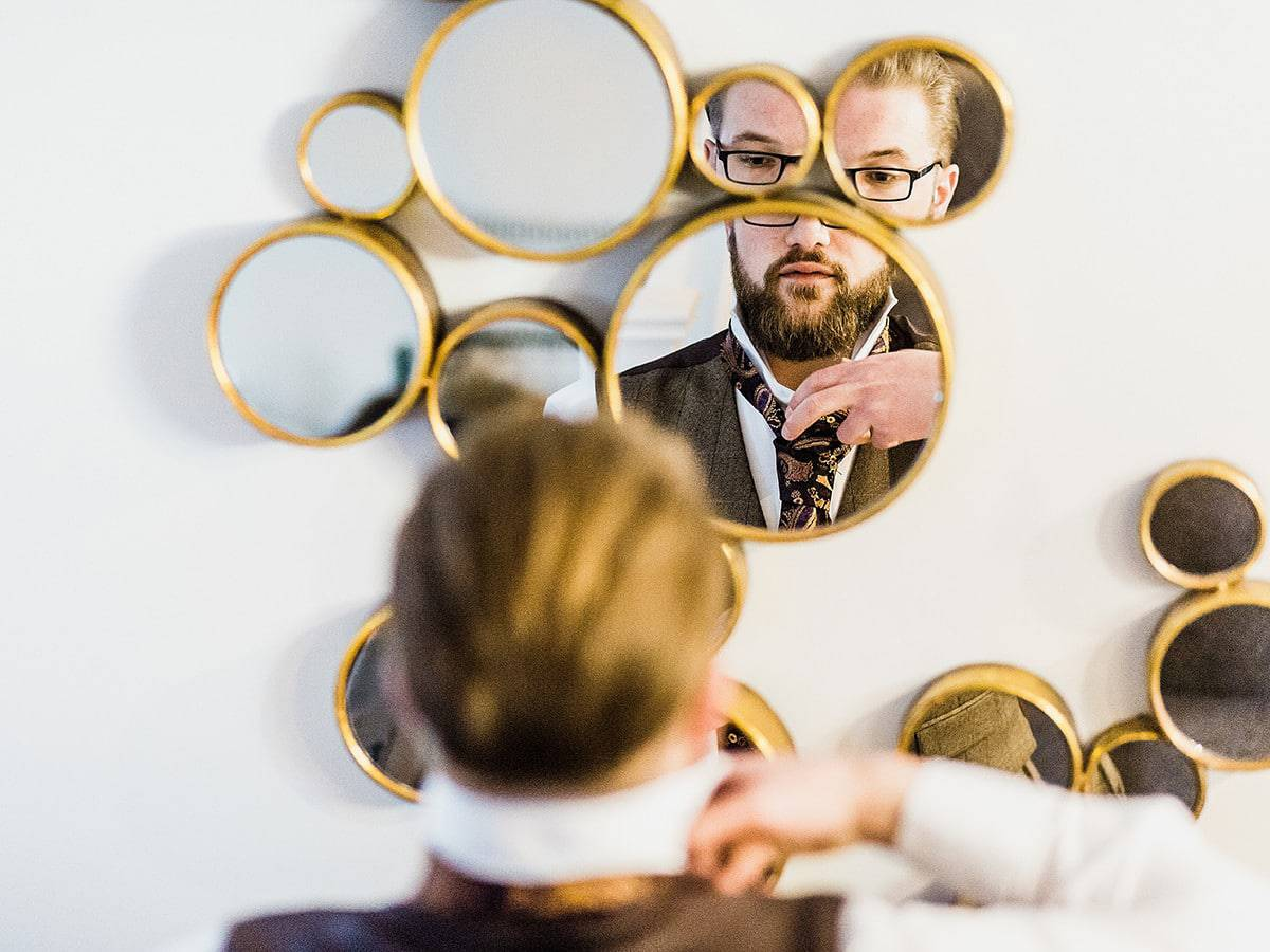 north east wedding photographer groom prep mirror
